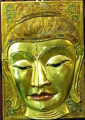 A  Buddha head made from wood with gold paint