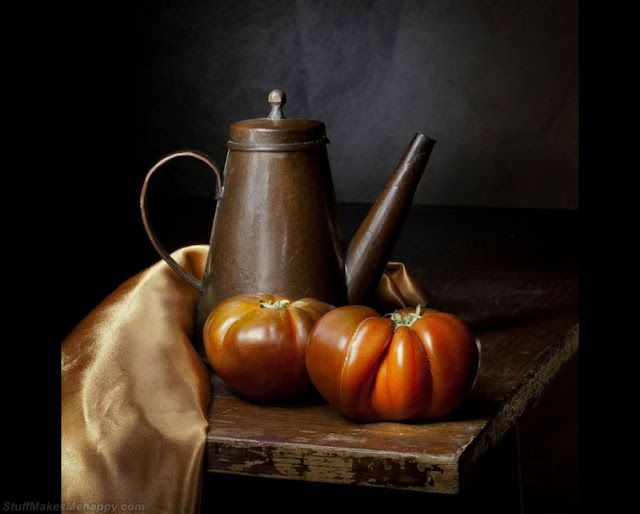 Tomatoes and an antique copper teapot. (Photo by SIMON CAPLAN):