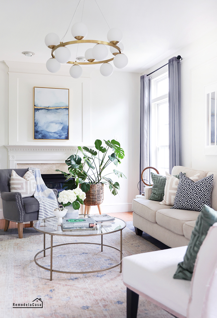 bright white and blue family room with monstera plant