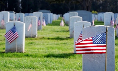 American flags and gravestones at Arlington Cemetery.