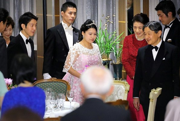 Crown Prince Naruhito and Crown Princess Masako at weeding banquet. Princess Ayako wore a pink silk dress designed by designer Norio Suzuki