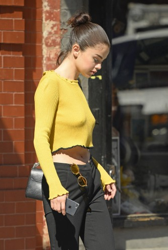 Selena Gomez ? Braless wearing a yellow sweater out in NYC
