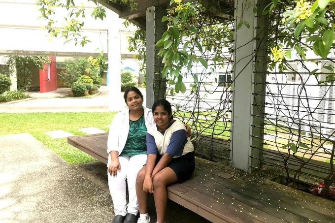 C. Abirami with her mother Madam Umadevi Balakrishnan. She makes it to express stream despite having to cope with caring for her father and siblings.