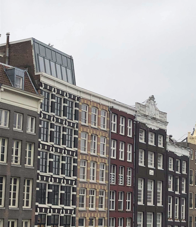 Tall houses in Amsterdam - different colours
