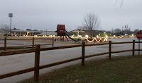 Christmas lights on fence rail at campground