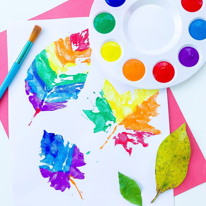 Rainbow painted leaves nature craft for kids