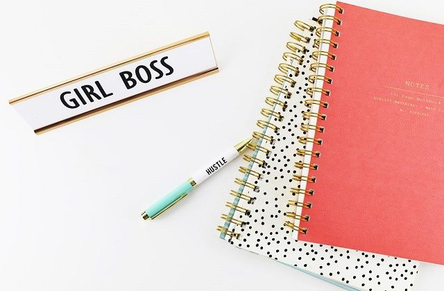 Girl Boss sign with Hustle pen and notebooks