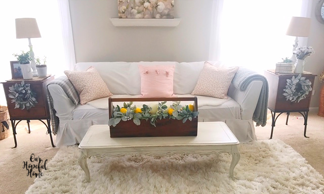 white slipcovered couch farmhouse living room wooden tool box coffee table centerpiece