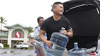Stocking up on drinking water at Safeway (Credit: AP Photo / Caleb Jones) Click to Enlarge.