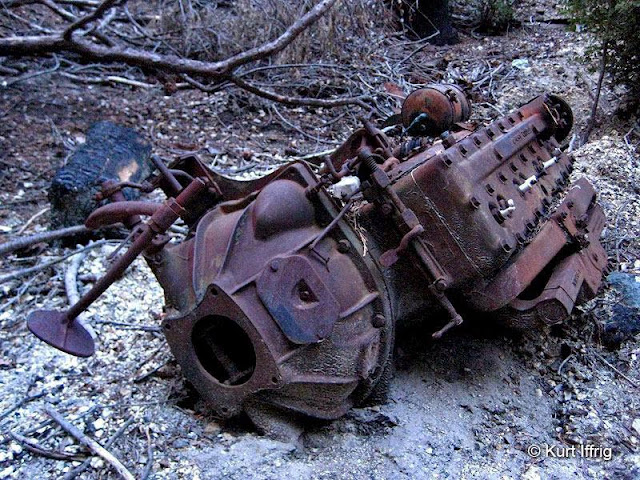 This is an old engine block found in a gully below the Bell Hartman Mine aka Boatwright Prospect.