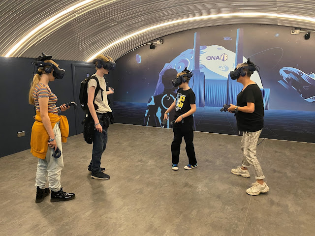 family playing in free roam room at DNA VR Battersea, London