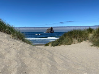 A view of Haystack Rock from a dune in Pacific City.