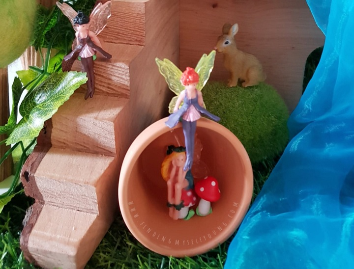 fairies hiding in a pot in the forest