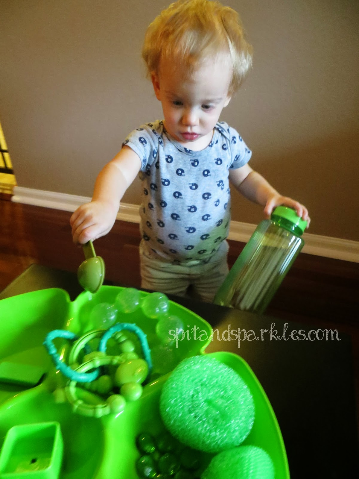 Find items around your home that are green for a color-themed sensory tray. #totschool #homeschool #earlylearning #StPatricksDay
