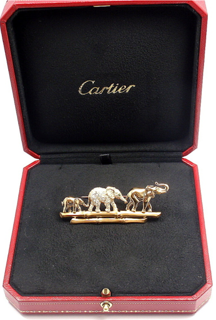 """Elephant Family"" brooch, Cartier. Gold, diamonds, and emeralds. Via Diamonds in the Library."