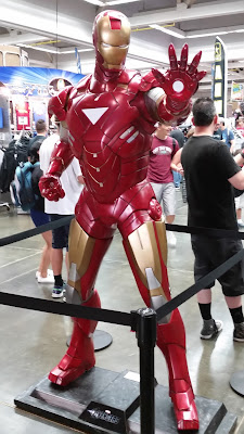 Statue of Iron Man holding out a hand in a blast pose.