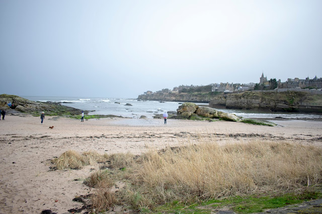 Beach landscape, people on beach, St Andrews town in background