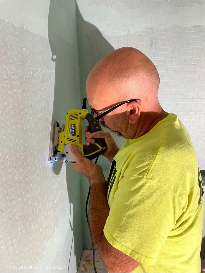 Hubby cutting hole for shower valve