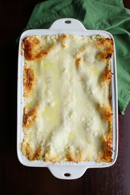 pan of chicken broccoli alfredo lasagna fresh from the oven with golden bits of cheese on top