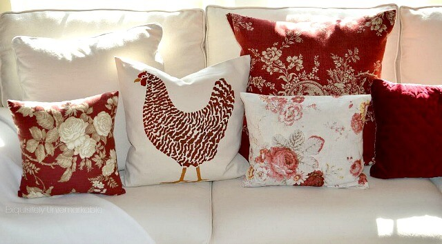 Red pillows on a white couch