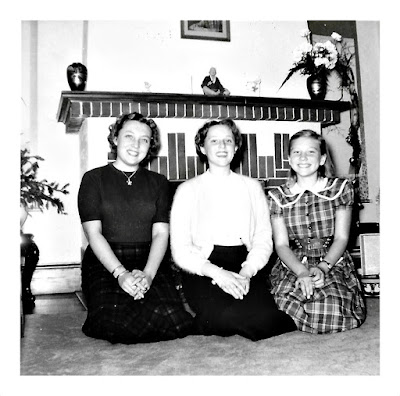 Lana K. Thomson, Tanya Sarsfield, and Elena Vasilev—the original Seoul Sisters—pose by a fireplace in 1950's San Francisco
