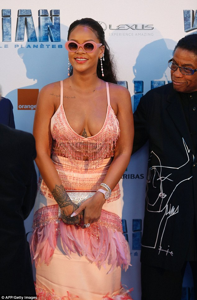 Image result for Braless Rihanna flaunts curves in sexy fringe outfit