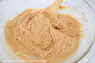 mixing up the dough for peanut butter kiss cookies