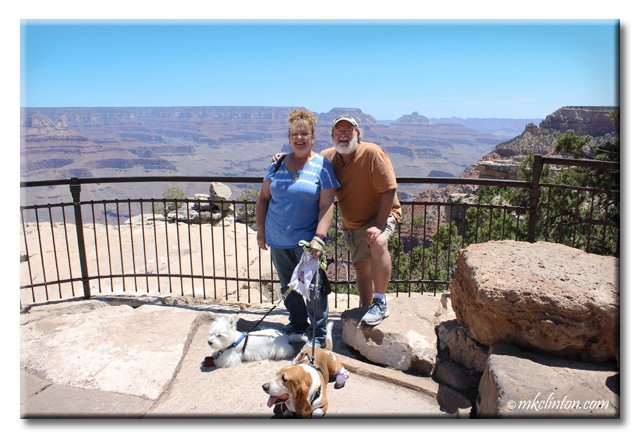 Man, woman and two dogs at Grand Canyon