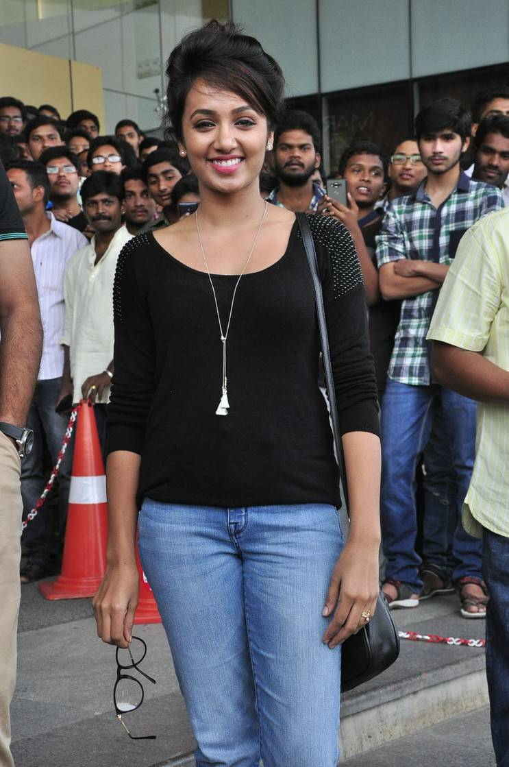Actress Tejaswi With Glass in Black Top Blue jeans