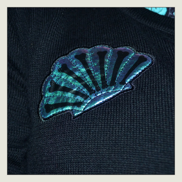 iron fist shell mermaid cardigan detail