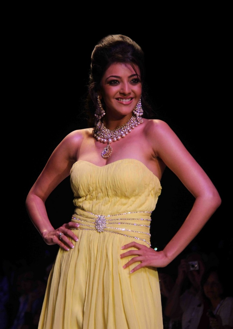 Kajal Agarwal Movie Event Stills In Sizzling Sleeveless Yellow Gown