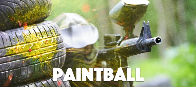 Yellow paint explodes near a man from a stag party playing paintball