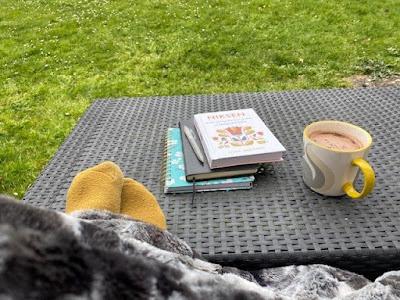 Reading in the garden under a blanket