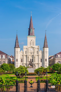 Iconic view of Saint Louis Cathedral with Jackson Square in the foreground (exterior)