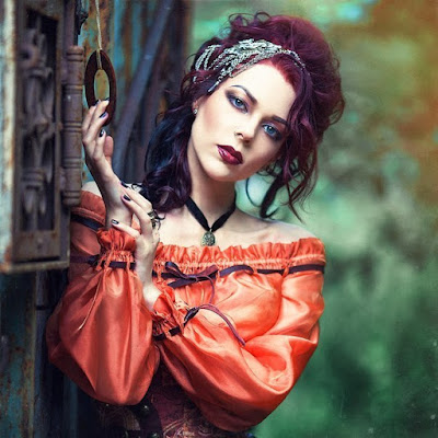 Steampunk autumn 2016/fall fashion. Color palette: orange, peach, brown and black on redhead girl.