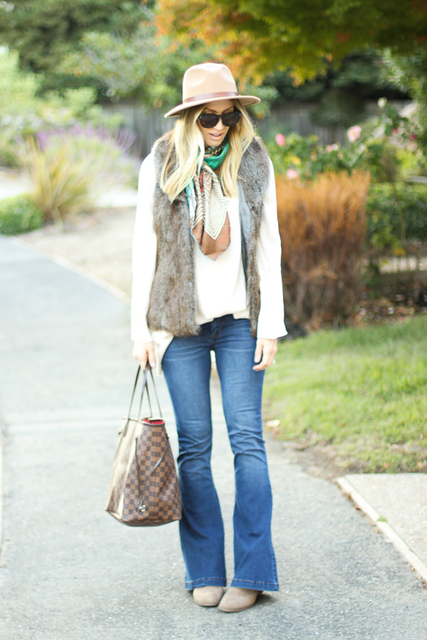 brown sure vest with jeans