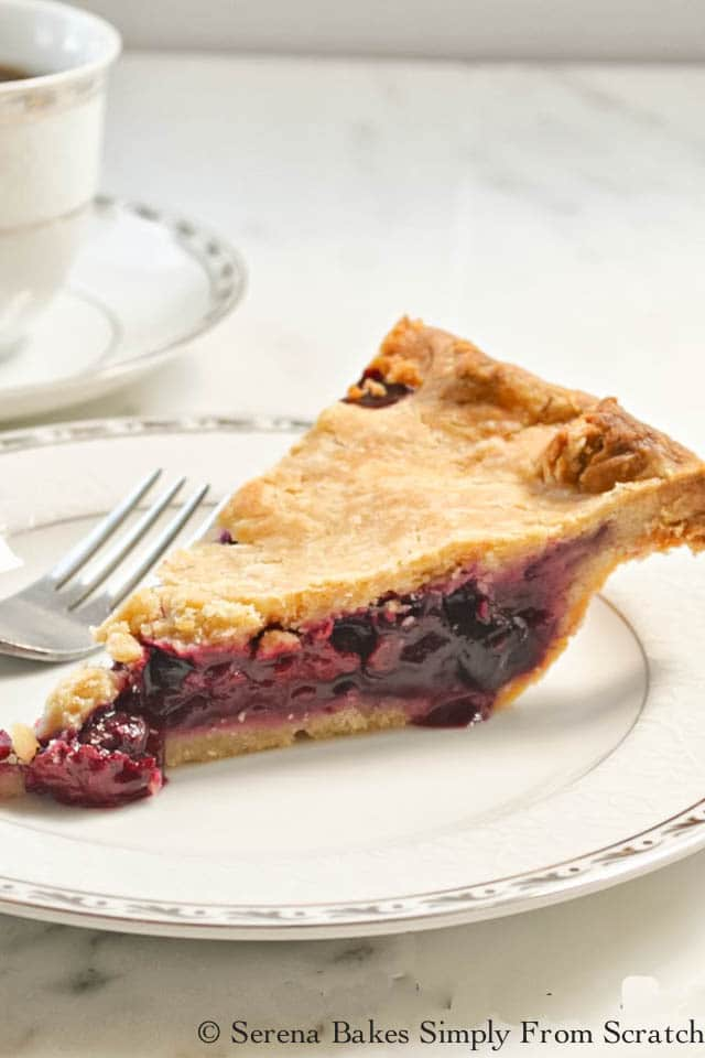 Mixed Berry Pie is a must have Thanksgiving Pie with Blackberries, Blueberries, Raspberries, and Strawberries in a Flaky Sour Cream Pie Crust. A favorite for dessert anytime and delicious made with fresh or frozen berries. Very Berry Pie is delicious from Serena Bakes Simply From Scratch.
