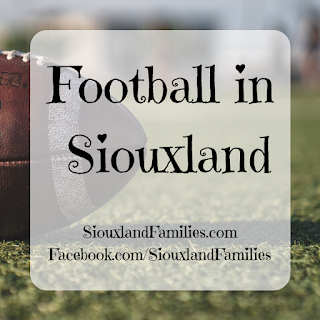 "in background, a brown leather football sits on a green football field with white markings. in foreground, the words ""Football in Siouxland"" and ""SiouxlandFamilies.com Facebook.com/SiouxlandFamilies"""