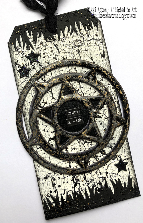 Frantage Embossed Stardust die on crackled black and white tag