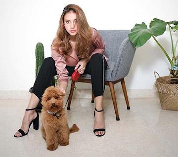 Naomi Paulinda dan Anjingnya