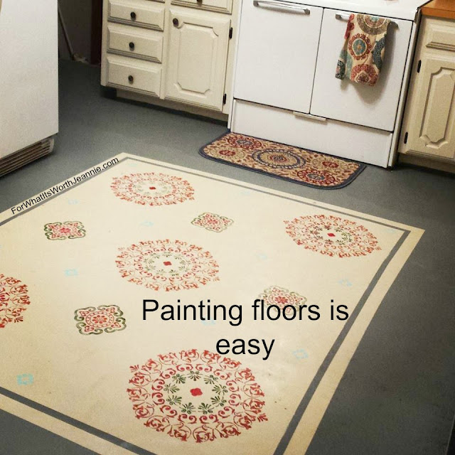 A painted faux rug on kitchen floor