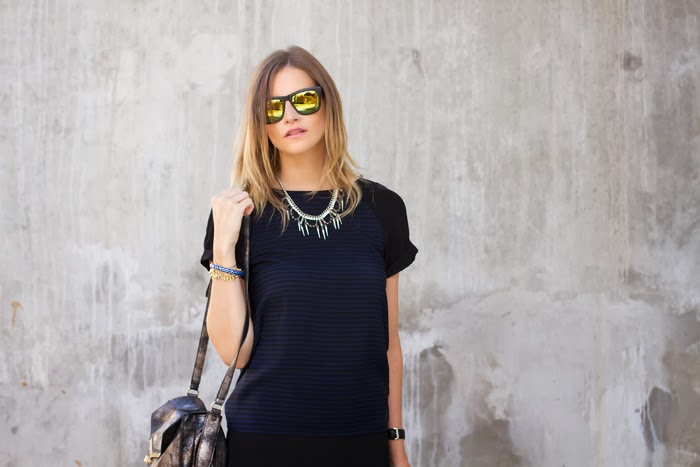 Vancouver fashion blogger, Alison Hutchinson, wearing a navy blue ad black striped Zara Tee, black crossover skirt from Necessary Clothing, black Sam Edelman Boots, and a silver Botkier Vlentina Bag