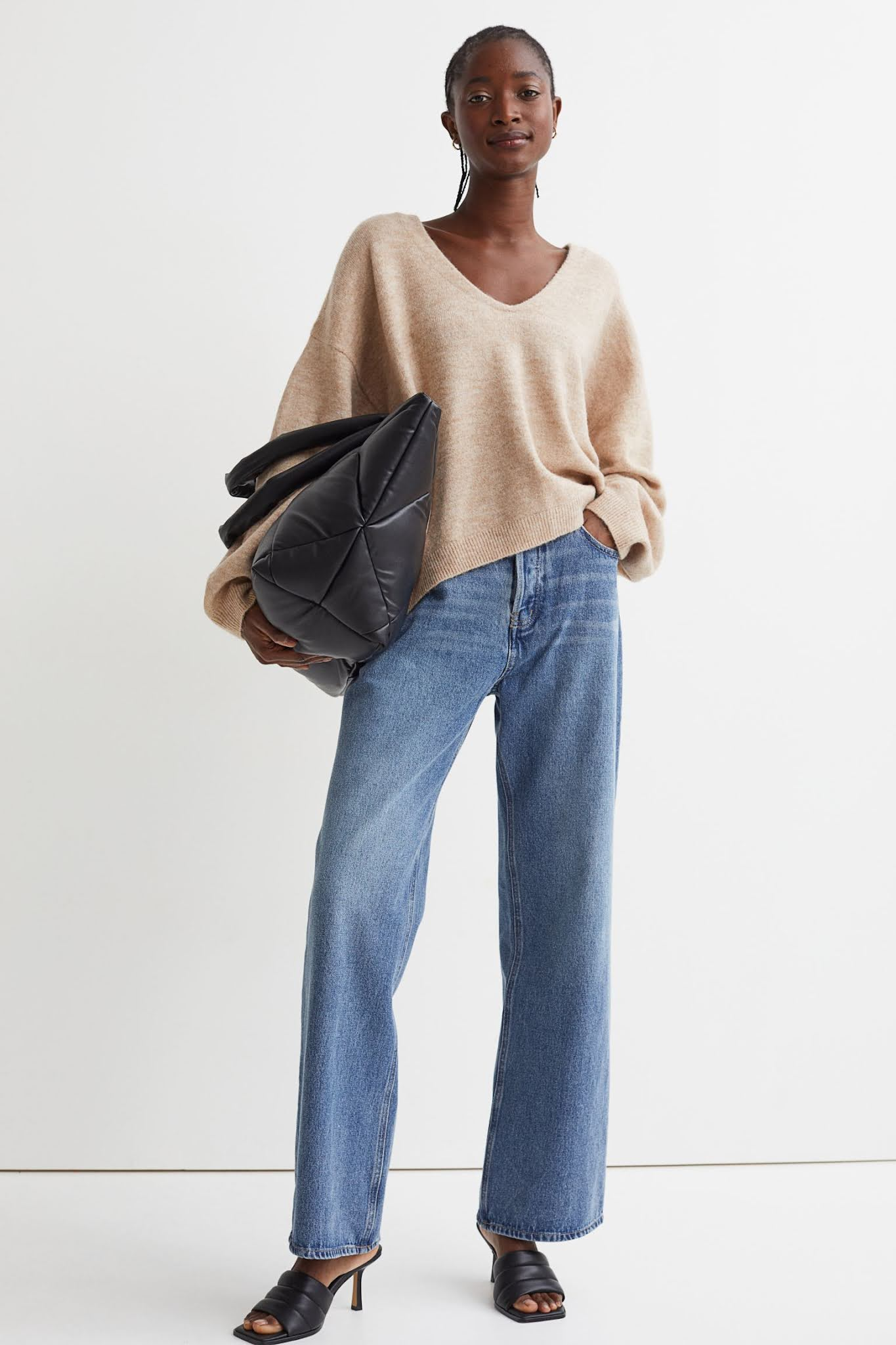 Affordable stylish fall outfit idea under-$100 sweater, wide leg jeans, and slip-on sandals