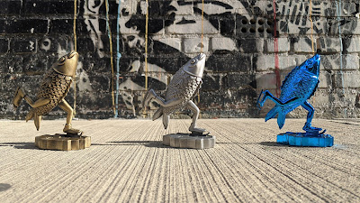 Skating Fish Pewter Statues by Jim Pollock x Bottleneck Gallery