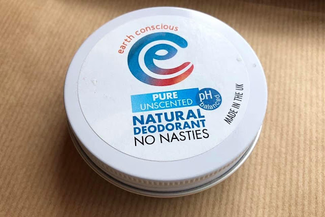 A white tin of Earth Conscious Deodorant