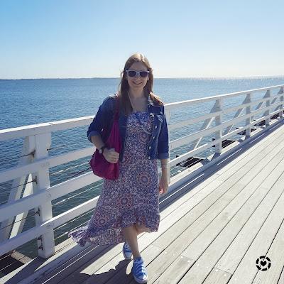 awayfromblue Instagram | mandala print high low maxi dress with denim jacket converse on pier