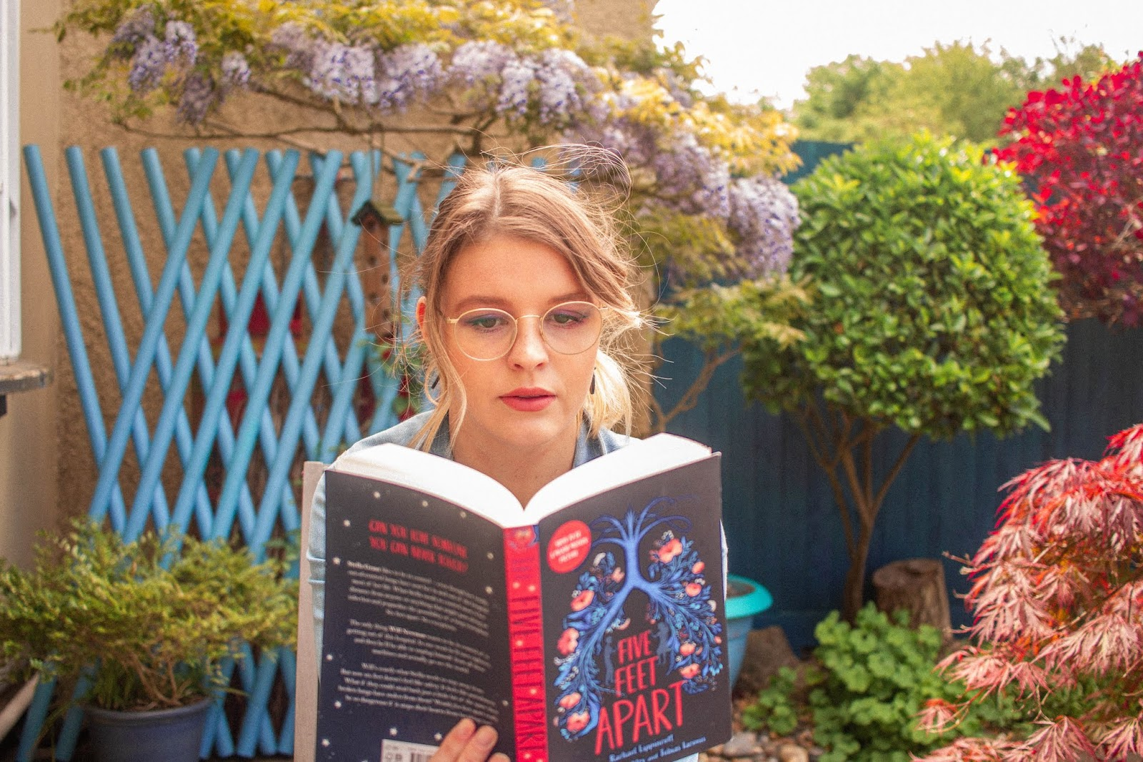 blonde girl reading five feet apart by Rachael Lippincott - book and film review blogpost