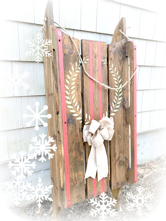 wooden sled with a wreath and stripes