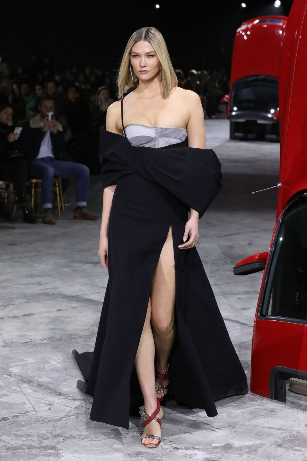 Karlie Kloss flashes her cleavage and toned legs in racy thigh-split corset gown as she walks the runway at Off White Paris Fashion Week show