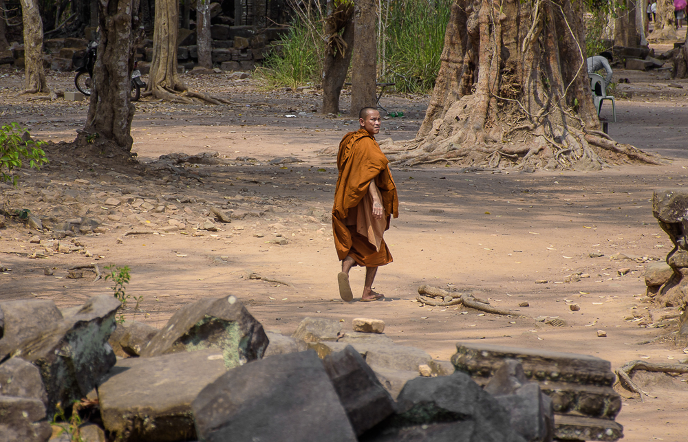 monk walking in Ta Prohm temple siem reap cambodia